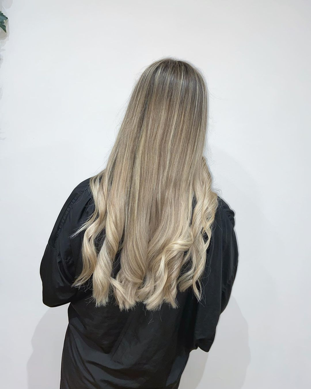 blonde highlights with slightly darker roots at mojo hair salon in Chorley